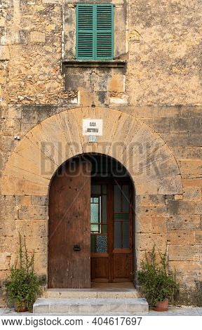 Campos, Spain; January 20 2021: Main Facade Of The Rectory House Of The Majorcan Town Of Campos. Sig