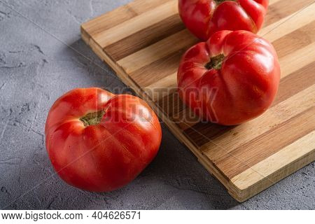Three Pink Heirloom Tomato Vegetables, Fresh Red Ripe Tomatoes On Wooden Cutting Board, Vegan Food,