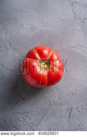 One Pink Heirloom Tomato Vegetable, Fresh Red Ripe Tomatoes, Vegan Food, Stone Concrete Background,