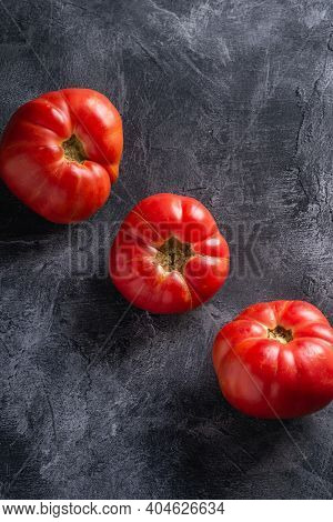 Three Pink Heirloom Tomato Vegetables In Row, Fresh Red Ripe Tomatoes, Vegan Food, Dark Stone Concre