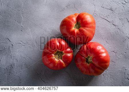 Three Pink Heirloom Tomato Vegetables, Fresh Red Ripe Tomatoes, Vegan Food, Stone Concrete Backgroun