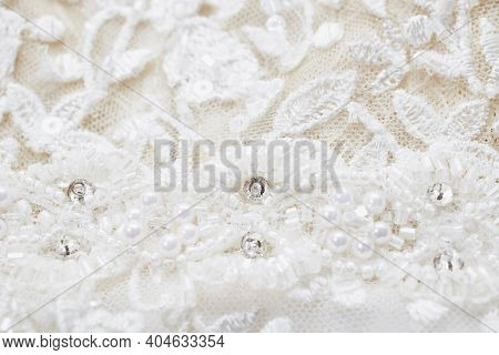 The Texture Of A Wedding Dress, Embroidered With Beads, Rhinestones And Sequins. Close-up, Macro