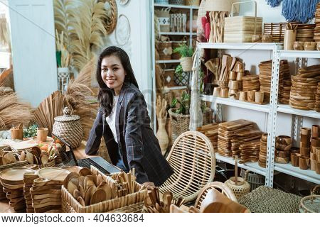 Woman Craft Designer Looks At The Camera While Standing In A Craft Workshop