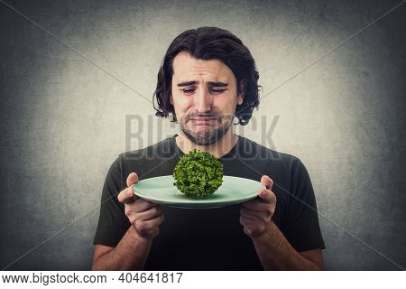 Desperate Man Crying As Has Only A Lettuce Batavia Salad On Dish Plate. Dissatisfied Vegan Guy Weepi