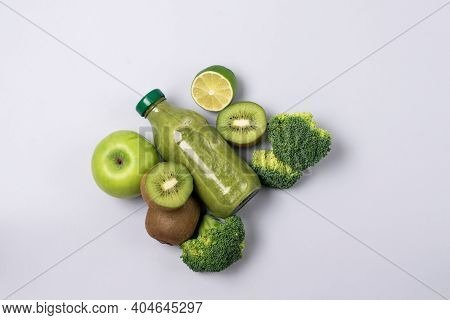 Glass Bottle Of Fresh Green Smoothie With Kiwi Broccoli Green Apples Lime And Babanas Healthy Detox
