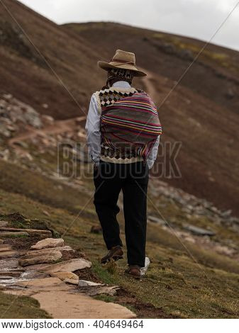Man In Traditional Andean Indigenous Clothes At Colorful Palccoyo Rainbow Mountain Palcoyo Cuzco Per