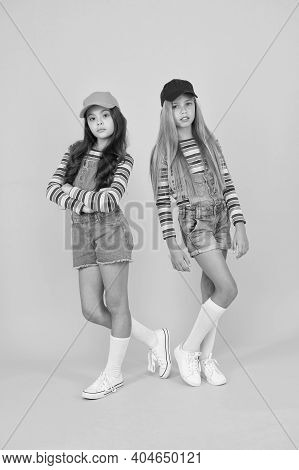 Casual Luxury. Small Girls In Casual Streetwear Style On Yellow Background. Casual Look Of Cute Litt