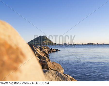 Landmark Mount Maunganui Across Tauranga Harbour From Sulphur Point Rock Groyne.
