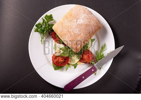 Sandwich With Vegetables And Herbs. Vegan Sandwich. Sandwich And Knife On A Plate.