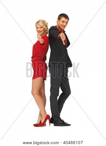 picture of man and woman showing thumbs up, down