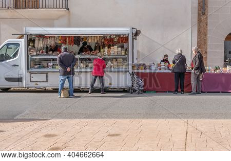 Campos, Spain; January 23 2021: General View Of The Weekly Street Market In The Town Of Campos. Sani