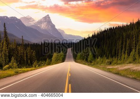 Scenic Road In The Canadian Rockies. Colorful Sunset Sky Art Render. Taken In Icefields Parkway, Ban