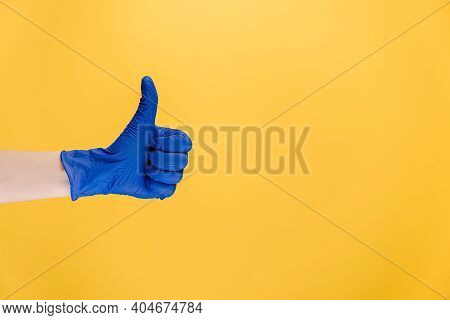 Close Up Of Male In Medical Protective Blue Gloves Makes Thumb Up Gesture, Demonstrates Approval Or
