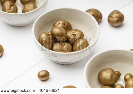 White Ceramic Bowl Full Of Chocolate Pralines. Sweet Truffles With Cinamon, Cardamom And Clove On A