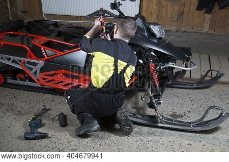 Repair And Maintenance Of Snowmobiles. Maintenance Of Motor Vehicles.