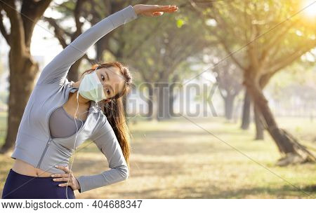 Young Asian Woman Wear Mask And Doing Exercises