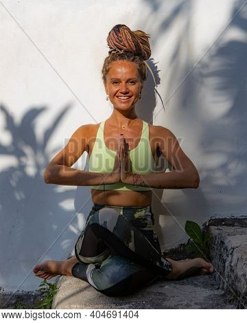 Outdoor Yoga Practice. Young Woman Practicing Gomukhasana, Cow Face Pose, Seated Asana In Hatha Yoga