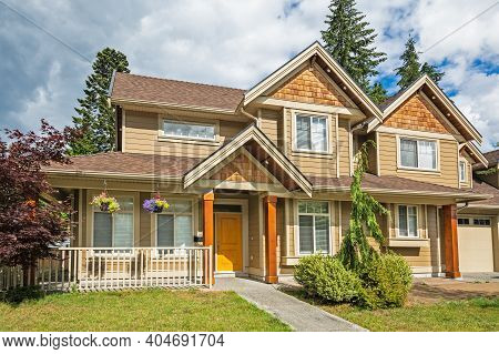 Nice Family House On Cloudy Sky Background