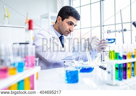 Confident Scientist Portrait Of Happy Male Scientist In A Chemistry Lab Scientist Holding Test Tube