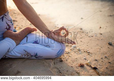 Close Up Gyan Mudra. Focus On Hand. Yoga On The Beach. Lotus Yoga Pose. Yogi Woman Sitting On Sand,