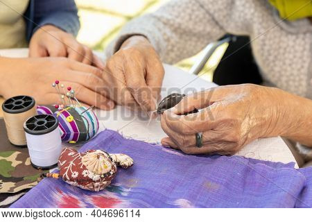 Elderly Woman And Daughter In The Needle Crafts Occupational Therapy For Alzheimer\\\'s Or Dementia
