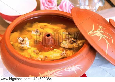 Food Specialty From Yunan Province, China: Air-pot Chicken Or Steam Pot Chicken. The Chicken Was Ste