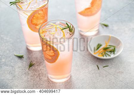 Cold And Refreshing Summer Grapefruit Cocktail Or Mocktail Garnished With Rosemary