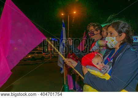 Haifa, Israel - January 23, 2021: Protestors With Flags And Signs Take Part In The Black Flags Prote