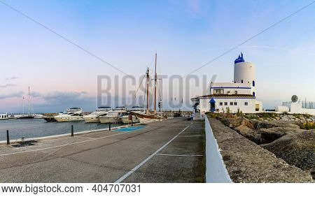 View Of The Marina And Harbor At La Duquesa In Andalusia At Sunset