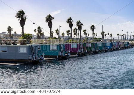 Colorful Houseboats In The Marina Near Gibraltar