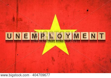 Unemployment. The Inscription On Wooden Blocks On The Background Of The Vietnam Flag. Unemployment G