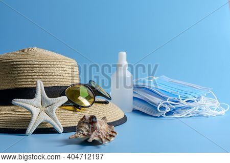 Summer Vacation Medical Protective Mask, Gloves, Antiseptic On Blue Background. Covid-19 Travel. Fla