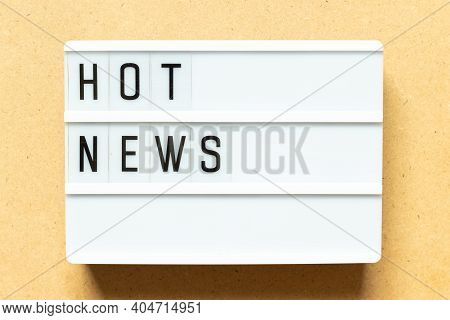 Lightbox With Word Hot News On Wood Background