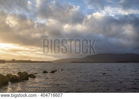 Majestic landscape image of Milarrochy Bay on Loch Lomond in Scottish Highlands with stunning Winter evening ligh