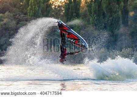 Krasnodar, Russia - October 25, 2020: Jet Ski Sportsman Turning Freestyle Somersault And Splashing I