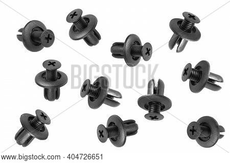 Macro Shot Plastic Black Clips For The Car. Panel Plastic Rivets Isolated On A White Background. Aut