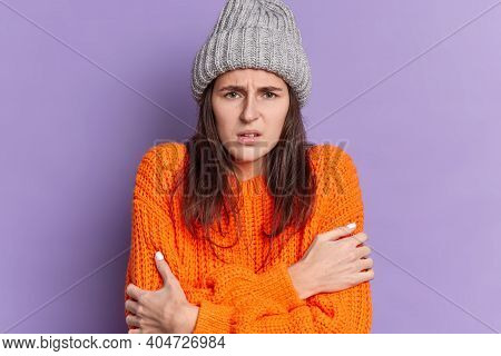 Sad Brunette Millennial Girl With Dark Hair Dressed In Knitted Wear Embraces Herself Feels Cold Trem