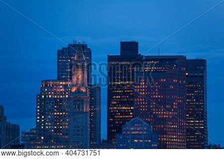 Night Photo Of A Clocktower On Jenney Plaza Of Boston Downtown From Main Channel