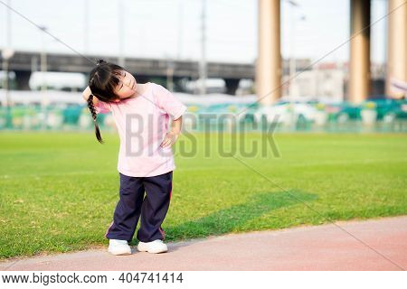 Cute Girl Was Exercising, Child Put One Hand On Waist And Other Hand Touched Back Of Head To Bend He