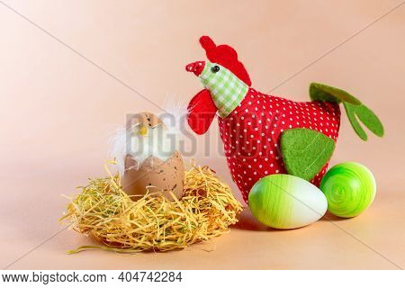 Composition Of Easter Eggs, Textile Chicken And Chicken In The Nest. Concept Of Interior Decoration