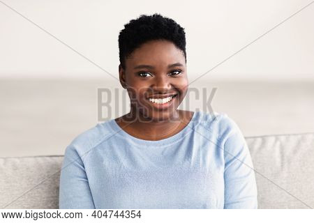 Natural Beauty. Headshot Portrait Of Casual Young Large Build Black Woman Smiling, Looking And Posin