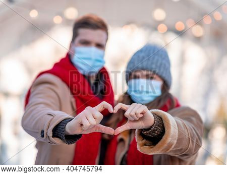 St. Valentines Day Celebration Concept. Heart Shape Sign Made By Man And Woman Hands, Selective Focu