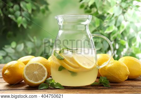 Natural Lemonade With Mint And Fresh Fruits On Wooden Table Against Blurred Background. Summer Refre
