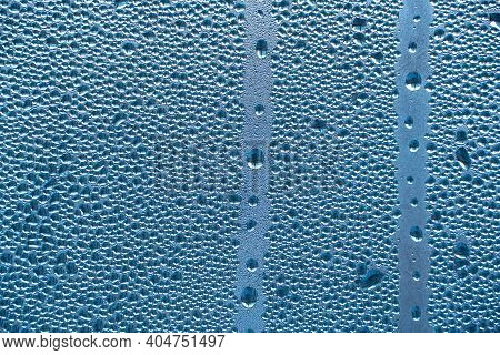 Abstract Background Ornament With Water Drops.raindrops On The Glass In Rainy Weather.the Glittering