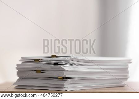 Stack Of Blank Paper With Binder Clips On Wooden Table. Space For Text