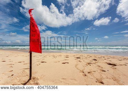 Red warning flag at beach. Phuket, Thailand.