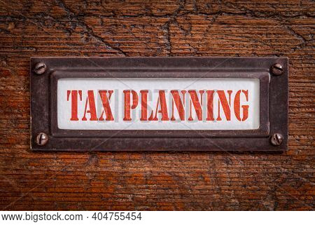 tax planning - a label on grunge wooden file cabinet. Business and financial concept.