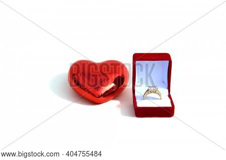 Wedding Ring.  Wedding Ring with a Red  Valentines Day Heart. Engagement Ring in a Red Velvet Ring Box. Isolated on white. Room for text.