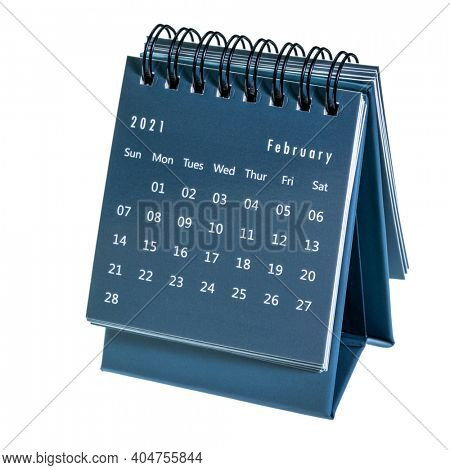 February  2021- spiral desktop calendar isolated on white,  time and business concept