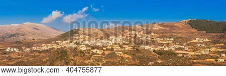View On Majdal Shams The Druze town in the southern foothills of Mountain Hermon, At Sunset,  Golan Heights, Israel.Snow on Hermon In Background